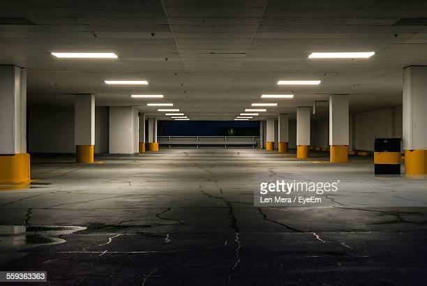 illuminated light fixtures in basement - car park stock pictures, royalty-free photos & images