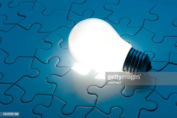Illuminated light globe on a jigsaw puzzle