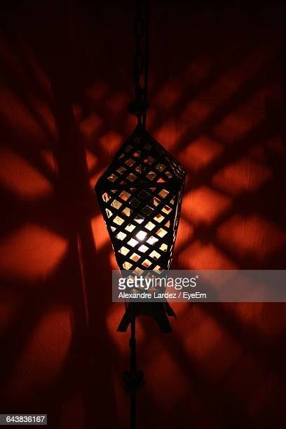 Illuminated Light Hanging On Wall