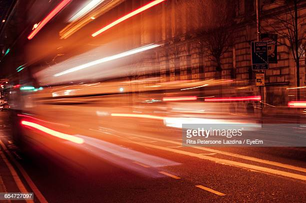 Illuminated Light Trails On Road At Night