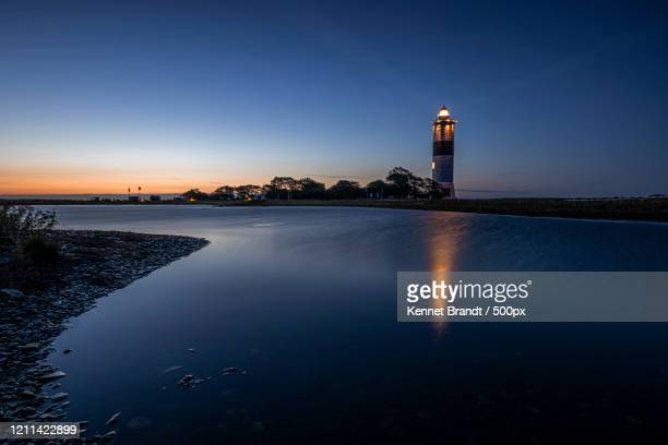 illuminated lighthouse at dusk, oland, sweden - images stock pictures, royalty-free photos & images