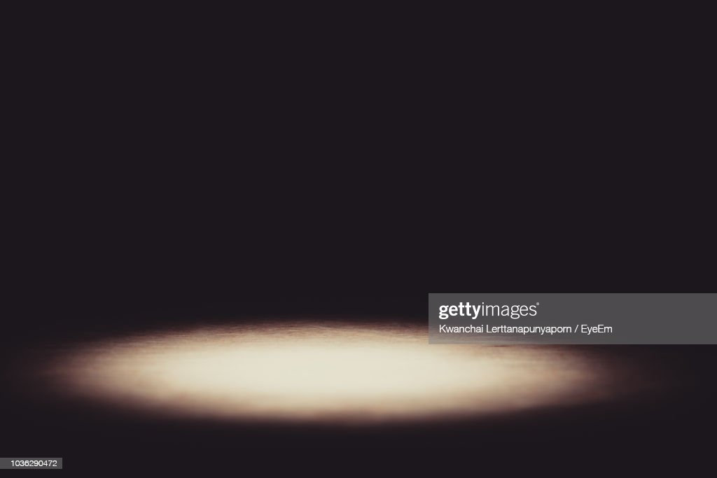 Illuminated Lighting Equipment Against Black Background : Stock Photo