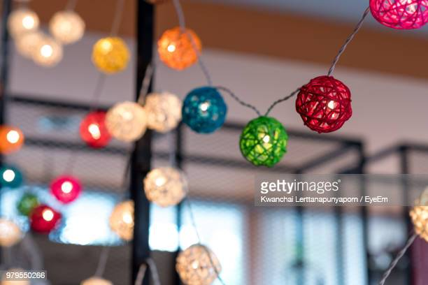 illuminated lighting equipment hanging against ceiling - ceiling stock pictures, royalty-free photos & images