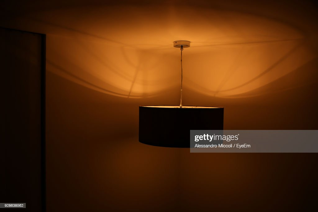 Illuminated Lighting Equipment Hanging In Room At Home : Stock Photo