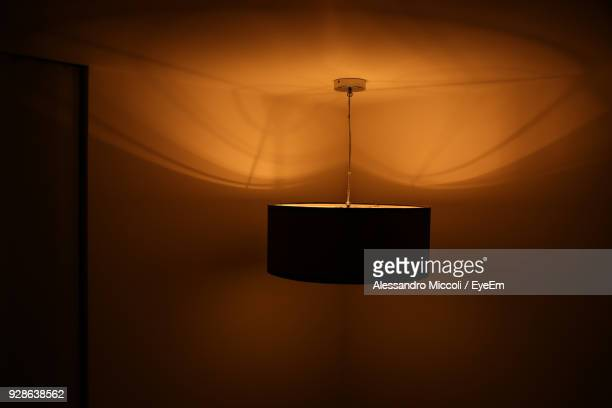 illuminated lighting equipment hanging in room at home - alessandro miccoli stockfoto's en -beelden