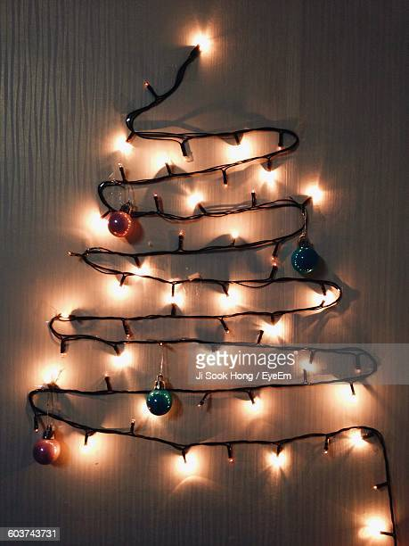 Illuminated Lighting Equipment On Wall At Home During Christmas