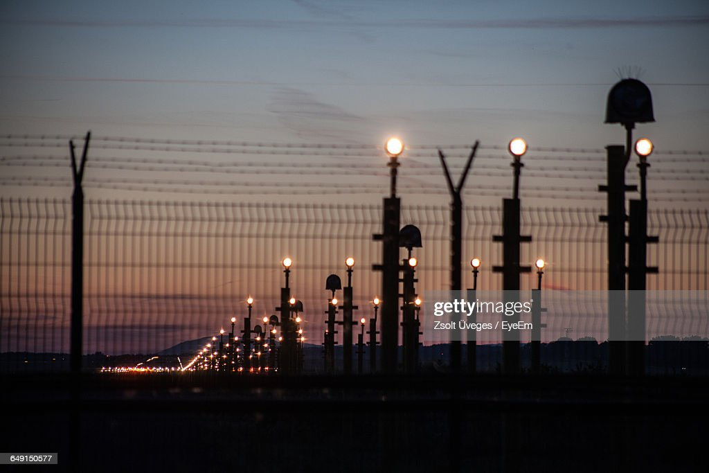 Illuminated Lights At Airport Runway : Stock Photo