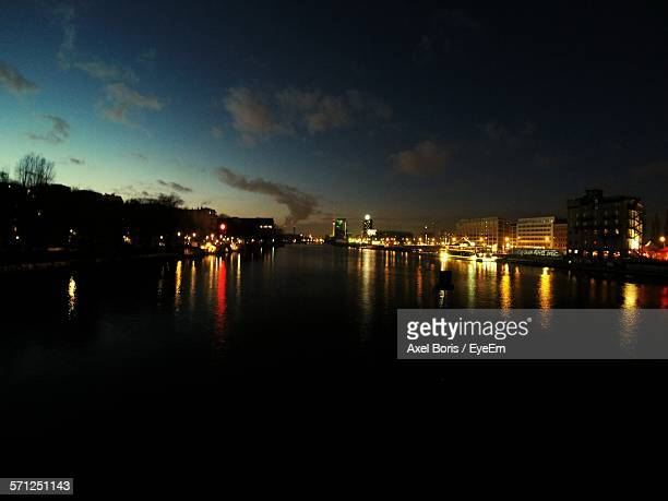 illuminated lights by building with reflections in spree river against sky - boris stock photos and pictures