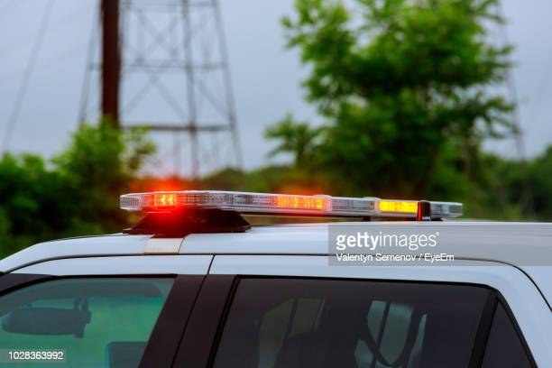 illuminated lights on car roof - police lights stock pictures, royalty-free photos & images