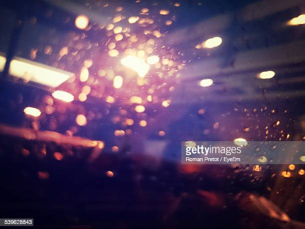 illuminated lights seen through window - roman pretot stock-fotos und bilder