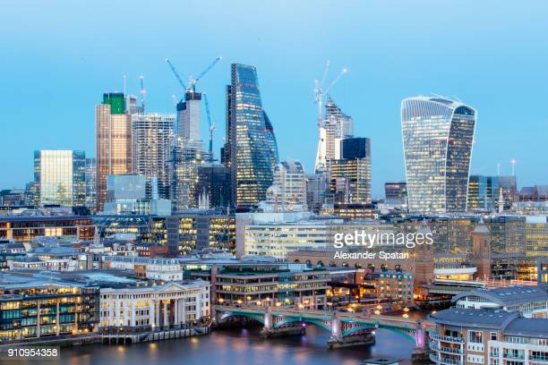Illuminated London skyline at dusk, Greater London, UK