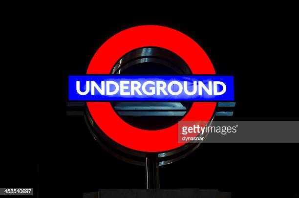 illuminated london underground sign - underground sign stock pictures, royalty-free photos & images