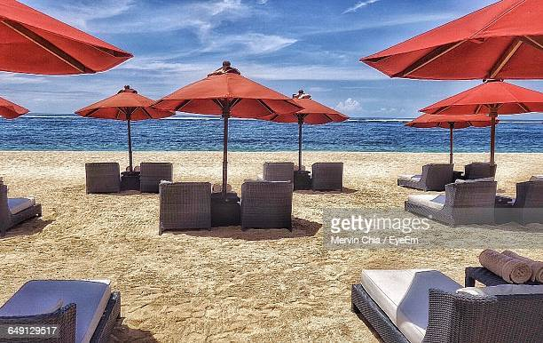 Illuminated Lounge Chairs At Beach