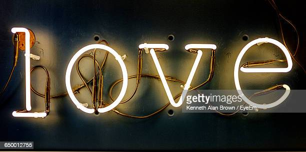 Illuminated Love Text On Wall At Night