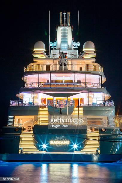 Illuminated luxury superyacht at night