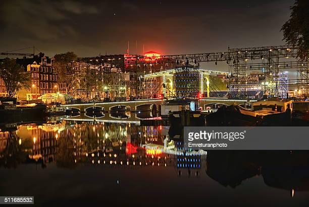 illuminated magerebrug bridge repairwork at night,amsterdam - emreturanphoto stock pictures, royalty-free photos & images