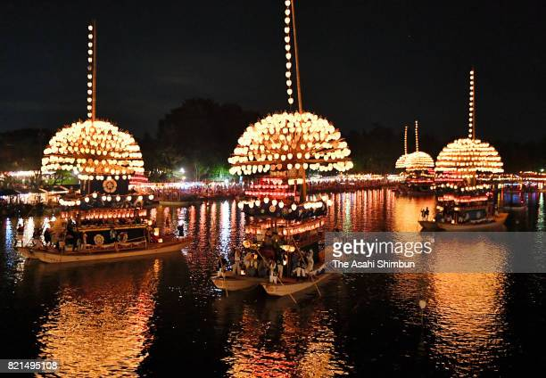 Illuminated 'Makiwarabune' ships are afloat during the Owari Tsushima Tenno Festival at Tennogawa Park on July 22 2017 in Tsushima Aichi Japan The...