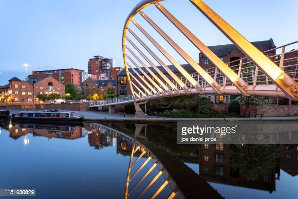 illuminated merchants footbridge, castlefield basin. deansgate, manchester, england - manchester england stock pictures, royalty-free photos & images