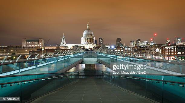 Illuminated Millennium Bridge With St Paul Cathedral Against Sky