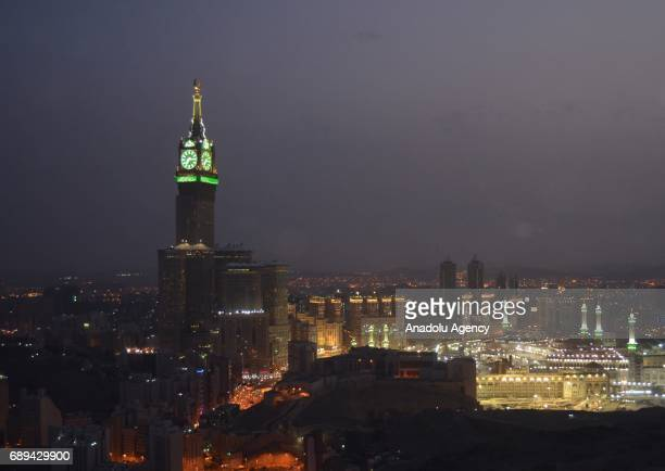 Illuminated minarets of Great Mosque of Mecca and Royal Clock Tower are seen during the holy month Ramadan in Mecca Saudi Arabia on May 27 2017