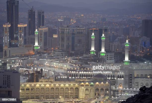 Illuminated minarets of Great Mosque of Mecca are seen during the holy month Ramadan in Mecca Saudi Arabia on May 27 2017