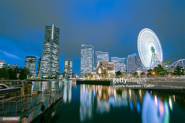 Illuminated Minato Mirai And Lake Against Clear Sky At Night