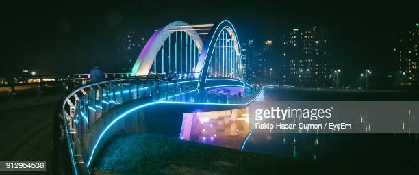 illuminated modern buildings against sky at night - bangladesh stock pictures, royalty-free photos & images