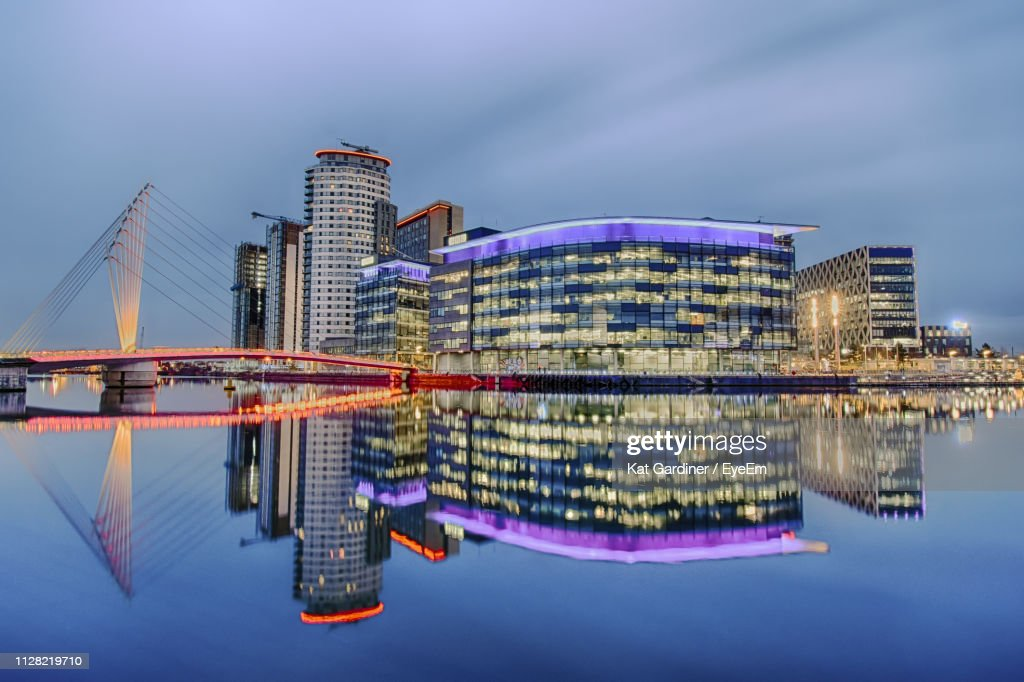 Illuminated Modern Buildings In City At Waterfront : Stock Photo