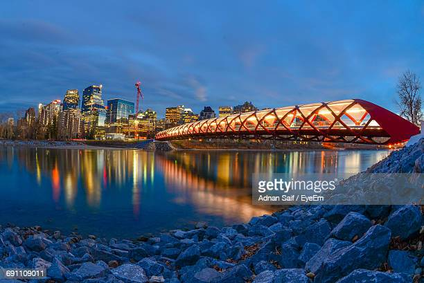 illuminated modern city at night - calgary stock pictures, royalty-free photos & images