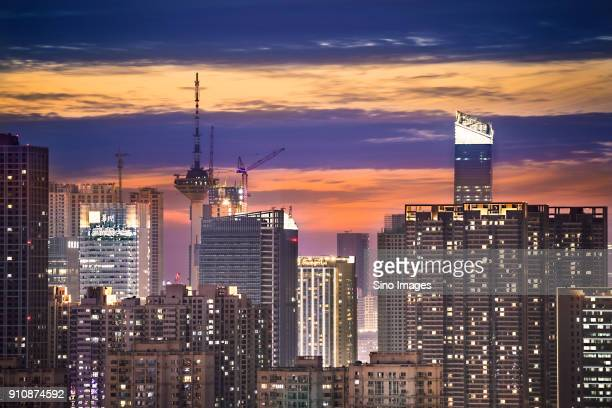 Illuminated modern skyscrapers at dusk, Shenyang, Liaoning, China