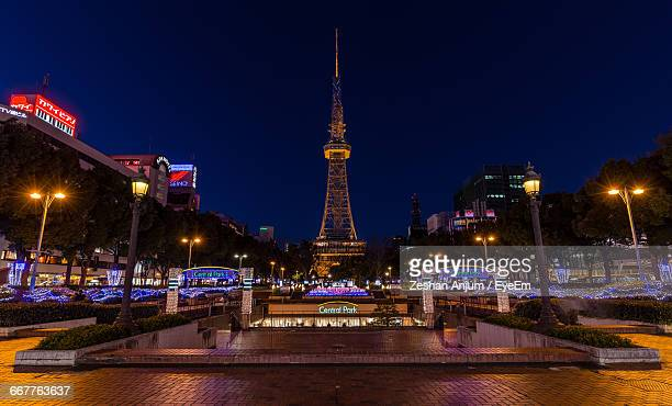 illuminated nagoya tv tower in city against sky - nagoya stock pictures, royalty-free photos & images