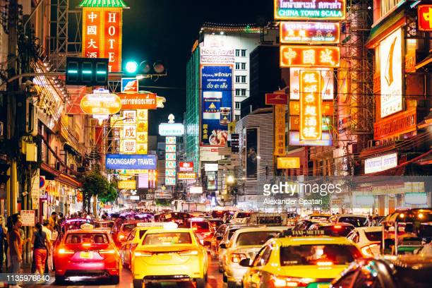 Illuminated neon lights and busy traffic in Chinatown, Bangkok, Thailand