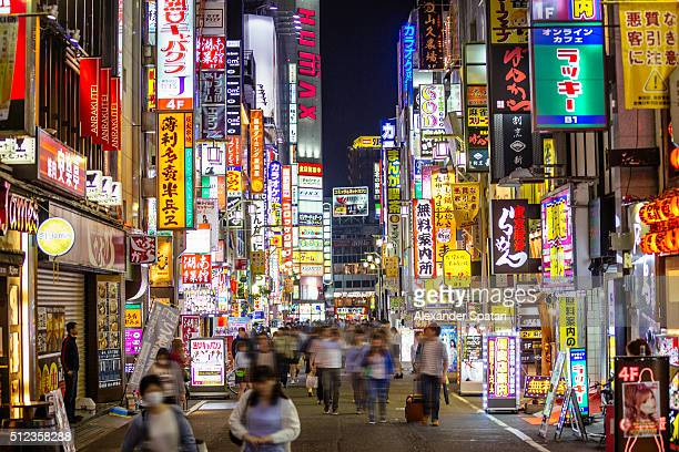 Illuminated neon signs at pedestrian street in Shinjuku at night, Tokyo, Japan