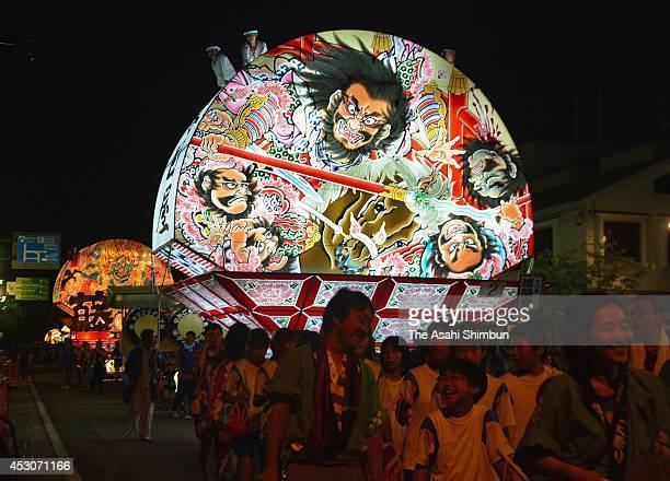 Illuminated 'Neputa' floats march on during the Hirosaki Neputa Festival on August 1 2014 in Hirosaki Aomori Japan The festival continues until...
