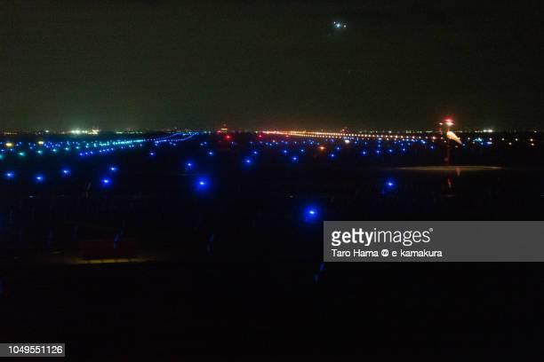 Illuminated night runaway of Tokyo Haneda International Airport (HND) in Japan