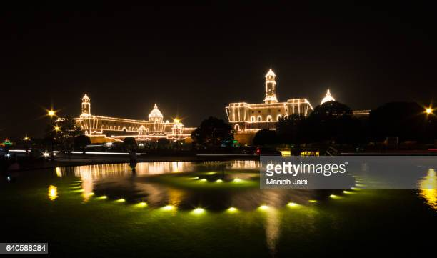 Illuminated North and South block administrative buildings after the Beating retreat in New Delhi.