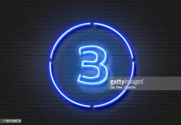 illuminated number 3 on wall - three stock pictures, royalty-free photos & images