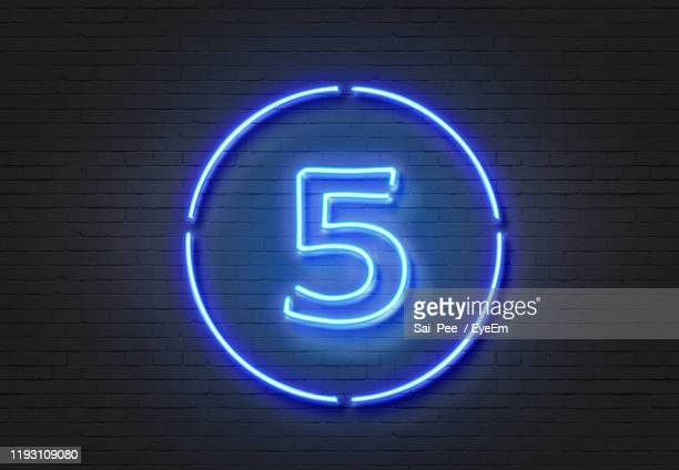 illuminated number 5 on wall - number 5 stock pictures, royalty-free photos & images