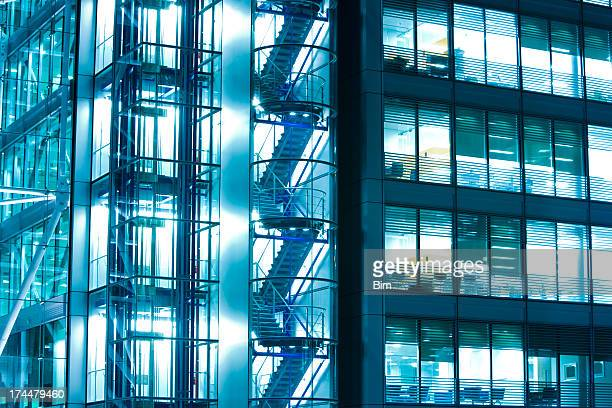 Illuminated office building at night, London, England