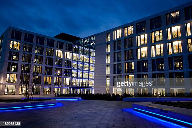 Illuminated office buildings entrance at dusk