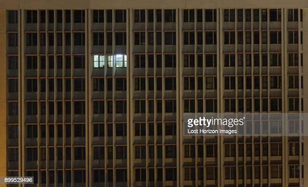 illuminated office window in office building at night, nairobi area, kenya, africa - working late stock pictures, royalty-free photos & images