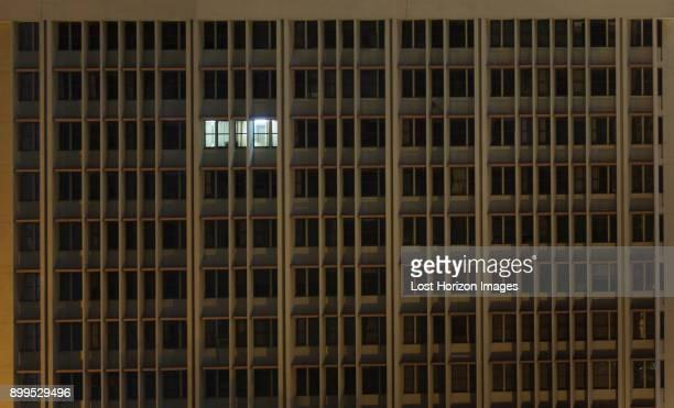 Illuminated office window in office building at night, Nairobi Area, Kenya, Africa