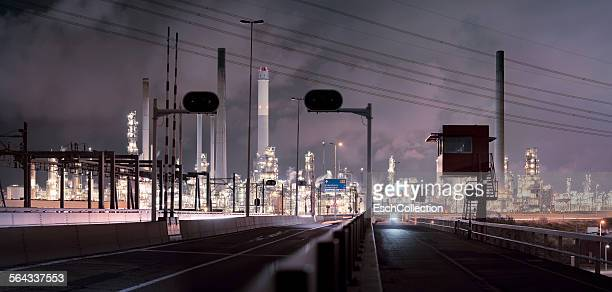 Illuminated oil refinery in Rotterdam at dawn