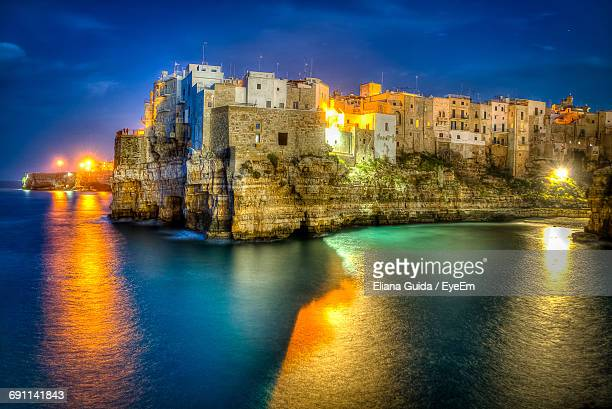illuminated old town from italy - polignano a mare stock photos and pictures