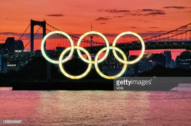 Illuminated Olympic rings are seen in front of the Rainbow Bridge ahead of the Tokyo 2020 Olympic Games on July 22, 2021 in Tokyo, Japan.