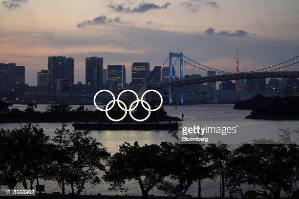 Illuminated Olympic rings float in the waters off Odaiba island in Tokyo, Japan, on Monday, June 8, 2020. Prime MinisterShinzo Abeended a national...