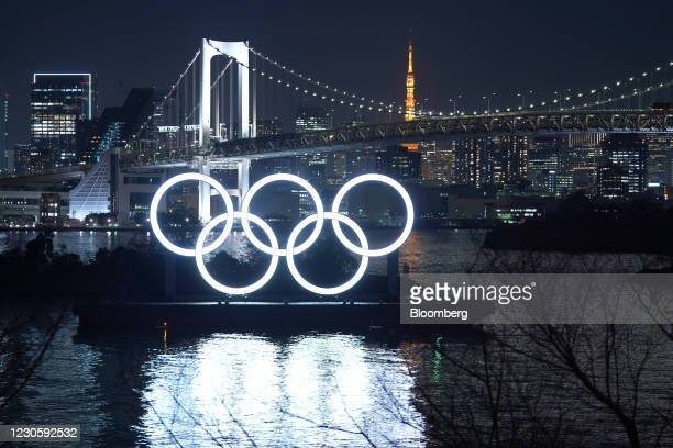 Illuminated Olympic rings float in the waters off Odaiba island in Tokyo, Japan, on Thursday, Jan. 14, 2021. While Japans infection count has been...