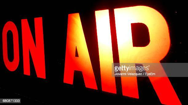 Illuminated On Air Sign Against Black Background