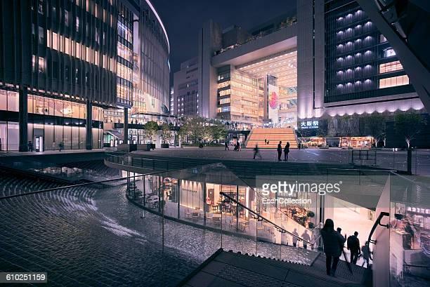 illuminated osaka station area in japan - 大阪市 ストックフォトと画像