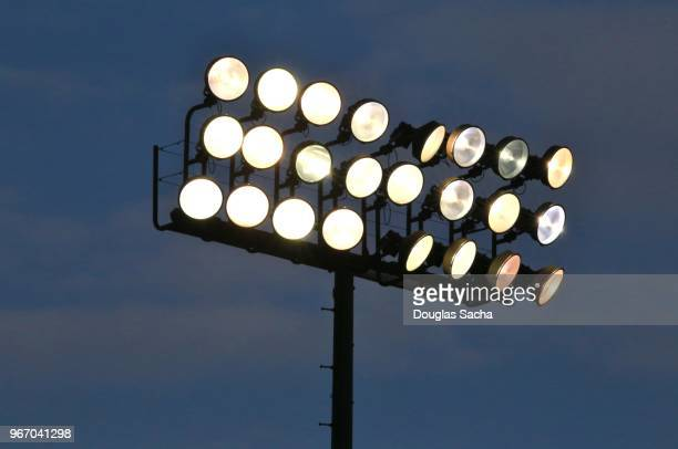 Illuminated overhead stadium scene lights